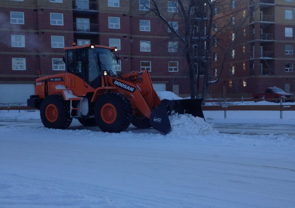 Loader clearing snow