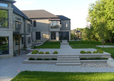 Broadway pavers and Pisa walls complete this formal backyard masterpiece
