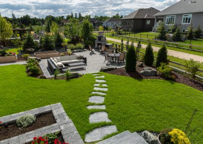 Grand Flagstone pieces make a beautiful stepping stone path down to this sunken patio and fire place