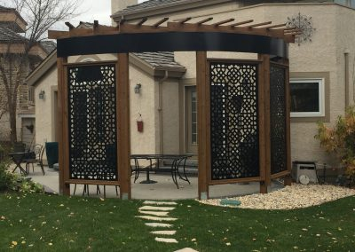 Curved pergola to fit this holland stone patio with powder coated steel privacy screens