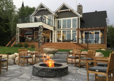 The perfect blend of brick and natural stone for this sunken patio and fire pit