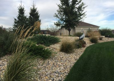 Low maintenance beds and borders with massive limestone accent rocks