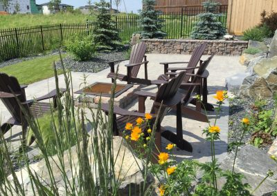Lower level patio and firepit bordered by plants to attract birds and butterflies