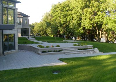 Multiple entertaining and viewing areas created to enjoy the Assiniboine River with this design