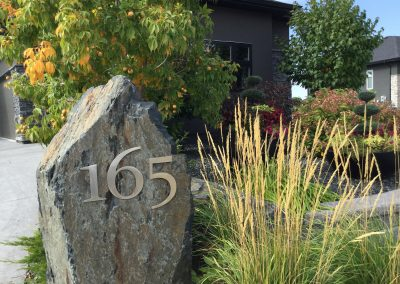 stainless steel house number on granite blast rock boulder