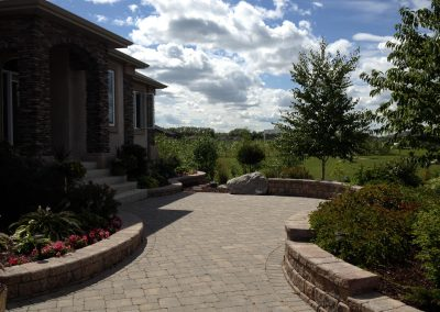 Beautiful front entrance patio is a hangout for company that is coming or leaving