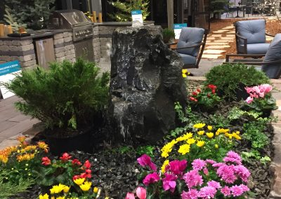 Natural granite boulder fountain at Winnipeg Home Show Galay Landscaping feature display