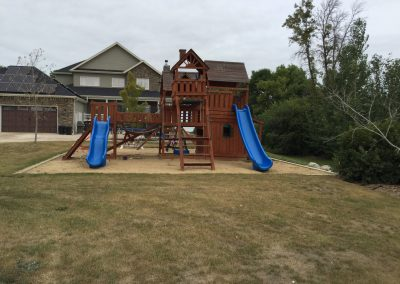 Playground and play structures on sand box with sub surface drainage