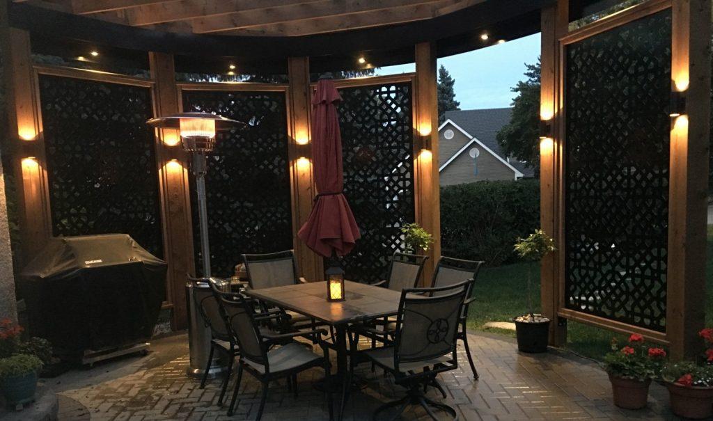 Beautiful lighting inside pergola in the evening