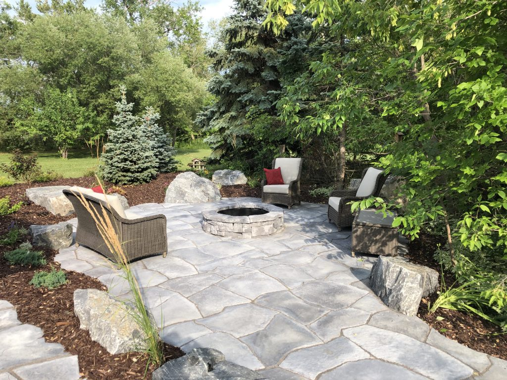 After Galay Landscaping, it's hard to believe you are looking at the same yard! Flagstone patio, belvedere fire pit and easy care mulch beds make this a place to come home to!